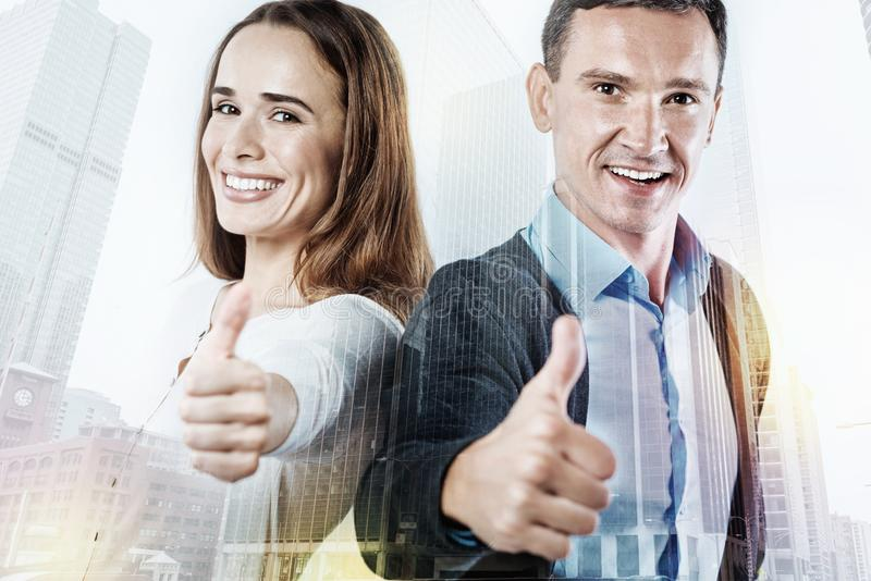 Portrait of two cute people showing a super gesture stock images