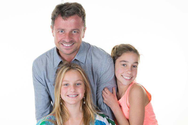 Portrait of two daughter sister girl hugging her daddy stock photo