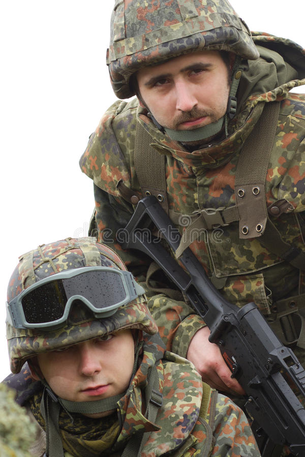 Portrait of two equiped soldiers stock photo