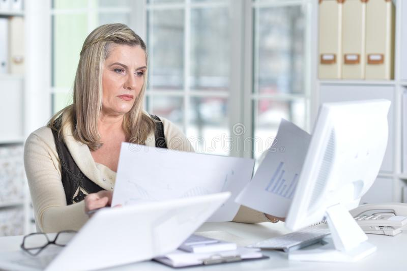 Portrait of two excited mature women working stock photo