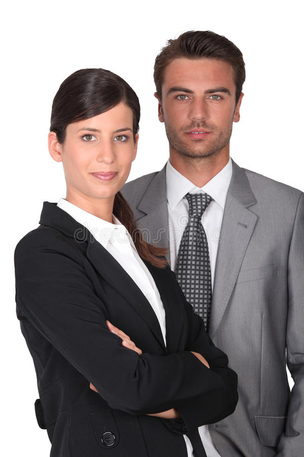 Portrait of two executives. Portrait of two young business executives royalty free stock image