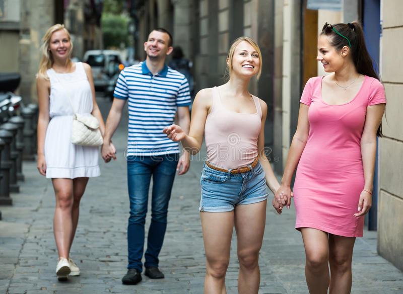Portrait of two female friends taking walk in town stock photography