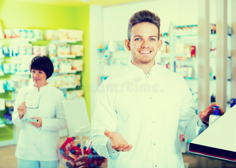 Download Portrait Of Two Friendly Glad Pharmacists Stock Image - Image: 83701519