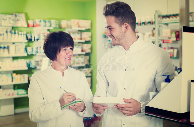 Download Portrait Of Two Friendly Pharmacists Stock Photo - Image of european, caucasian: 83701964