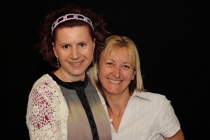 Portrait of two friendly women stock photos