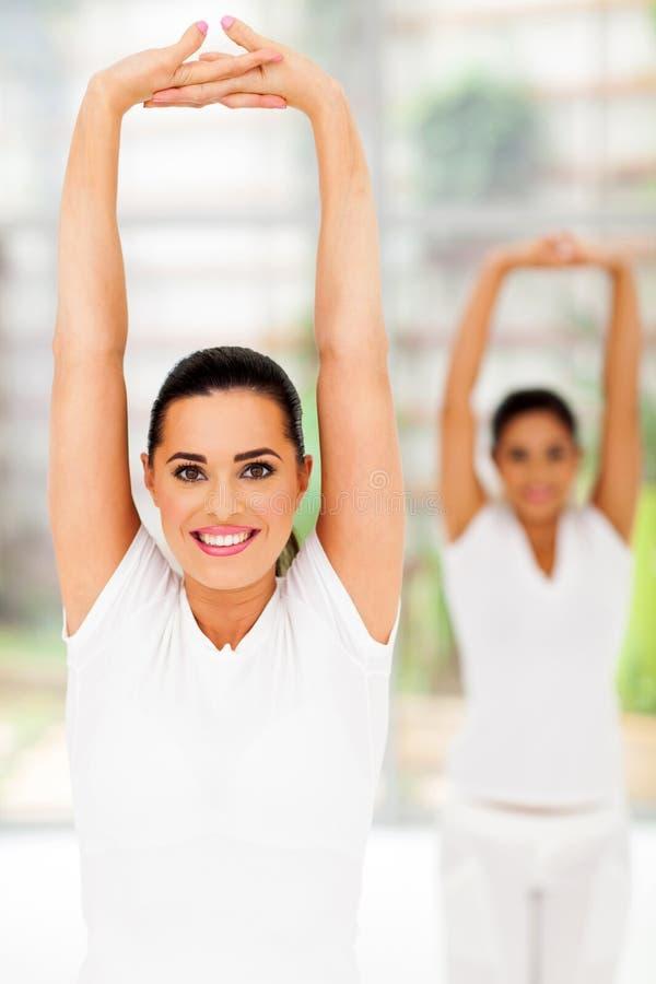 Girls yoga exercise stock images
