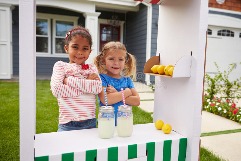Portrait Of Two Girls Running Homemade Lemonade Stand royalty free stock images