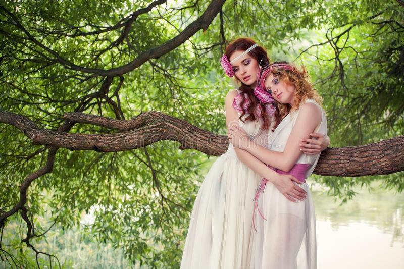 Portrait of two girls in white dresses. royalty free stock photo