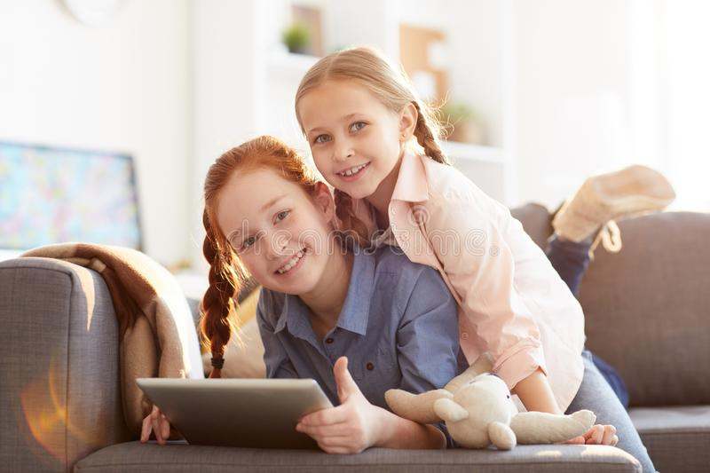 Two Cheerful Sisters at Home royalty free stock images