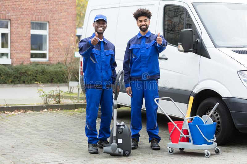 Portrait Of Two Happy Male Janitor stock images