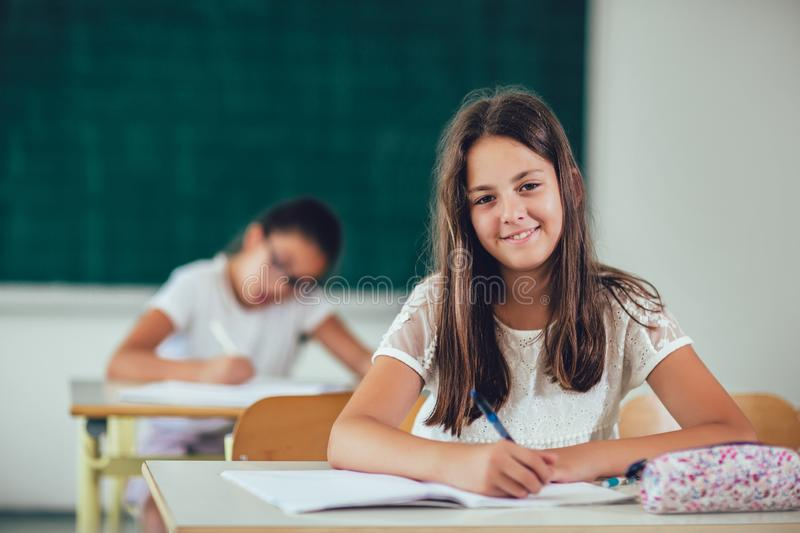 Portrait of happy schoolgirls in a classroom royalty free stock photography