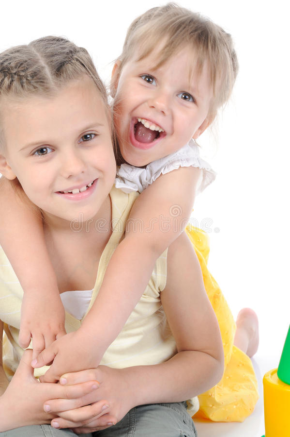 Portrait of two happy sisters. royalty free stock photo