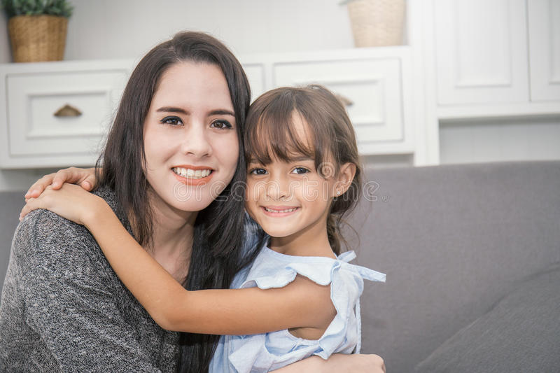 Portrait of two happy sisters in the living room royalty free stock photo