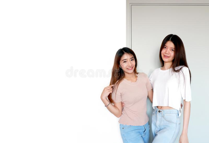 Portrait of a Two Happy Smile Young Woman. Best Women Friends Fun in Casual Standing Isolated over White Wall with Copy Space stock image