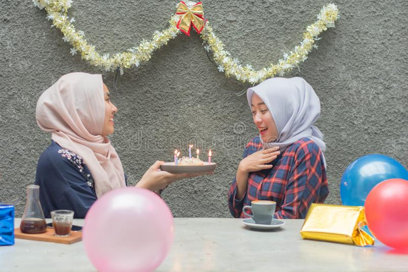 Portrait of two hijab woman bestfriend having time together in celebrate event. Portrait of two hijab women bestfriend celebrate birthday with pancake and and stock photos