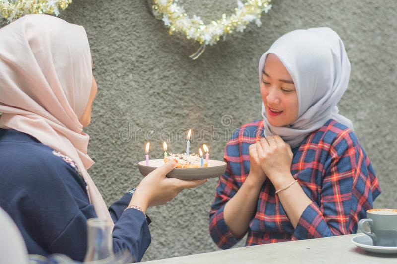 Portrait of two hijab woman bestfriend having time together in celebrate event. Portrait of two hijab women bestfriend celebrate birthday with pancake and and royalty free stock images
