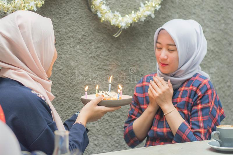 Portrait of two hijab woman bestfriend having time together in celebrate event. Portrait of two hijab women bestfriend celebrate birthday with pancake and and royalty free stock photos