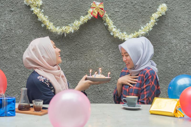 Portrait of two hijab woman bestfriend having time together in celebrate event. Portrait of two hijab women bestfriend celebrate birthday with pancake and and stock photography