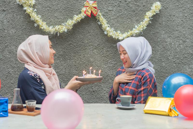 Portrait of two hijab woman bestfriend having time together in celebrate event. Portrait of two hijab women bestfriend celebrate birthday with pancake and and royalty free stock photo