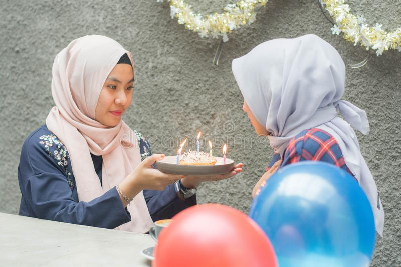 Portrait of two hijab woman bestfriend having time together in celebrate event. Portrait of two hijab women bestfriend celebrate birthday with pancake and and stock images