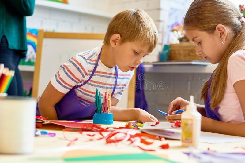 Children Doing Handmade Crafts in School stock photography