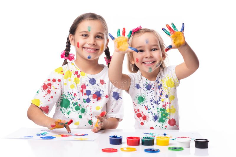 Portrait of Two Little Child Girls Playing with Finger Paint stock photos