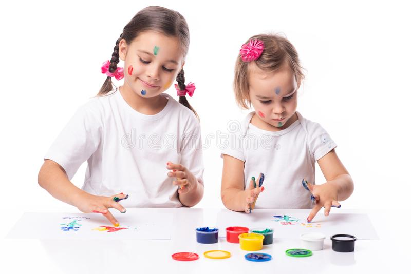Portrait of Two Little Child Girls Playing with Finger Paint royalty free stock photos