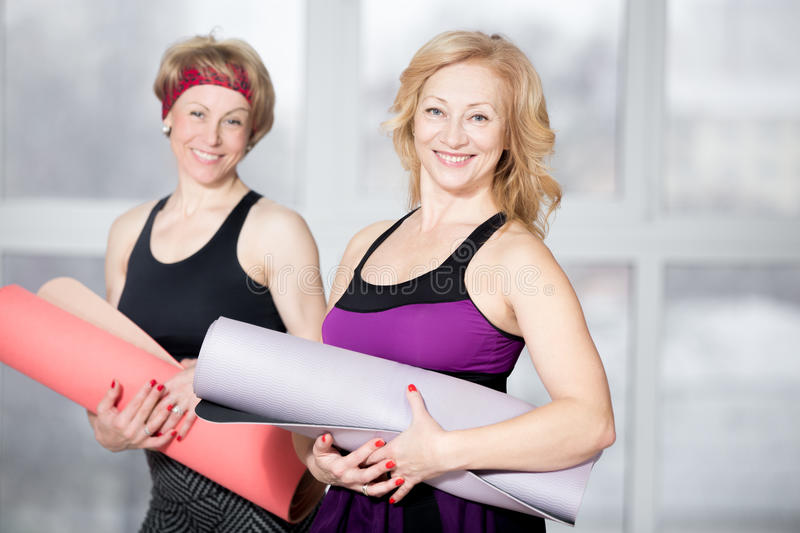 Portrait of two mature athletic women royalty free stock images