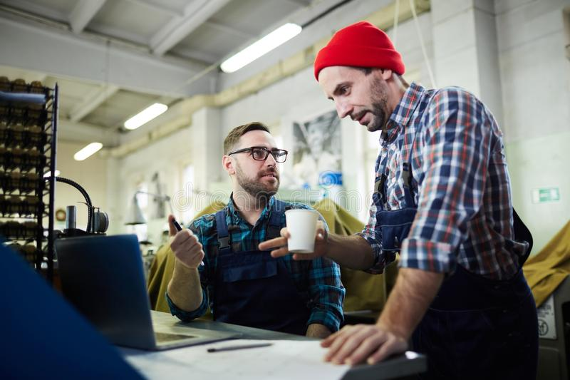 Two Mature Men Working at Factory stock photography