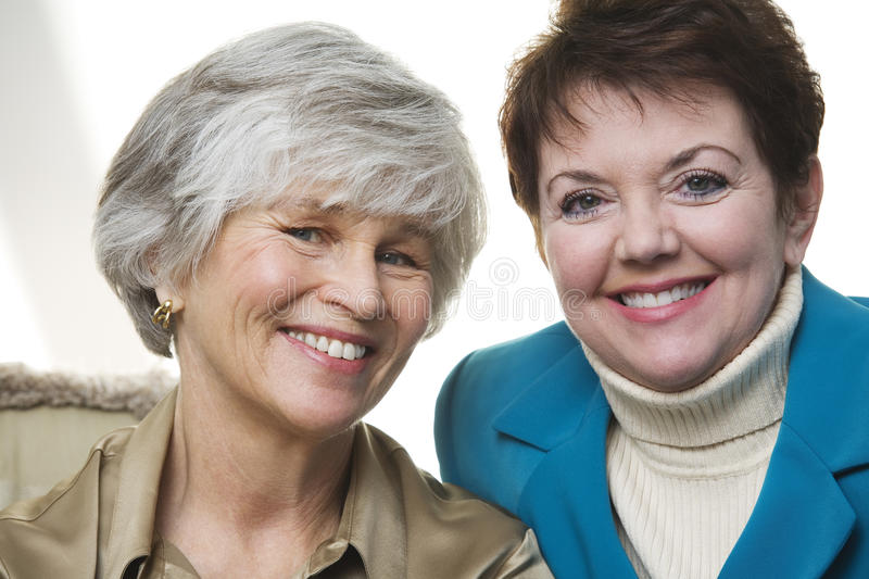 Portrait of two mature women. Portrait of two smiling mature women stock image