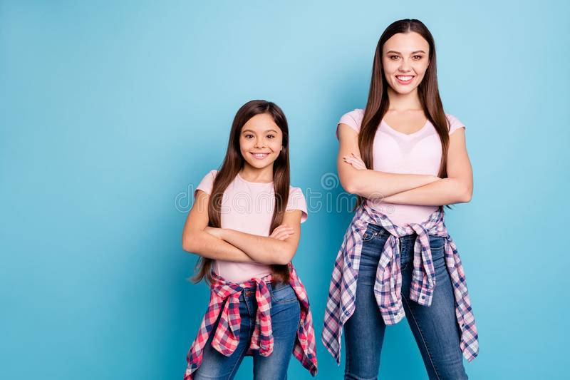 Portrait of two nice-looking charming cute lovely winsome attractive cheerful cheery straight-haired girls folded arms. Isolated on bright vivid shine green stock image
