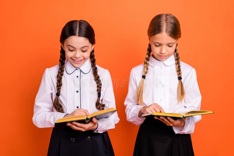 Portrait of two person nice attractive lovely charming cute cheerful focused concentrated pre-teen girls preparing test royalty free stock photos