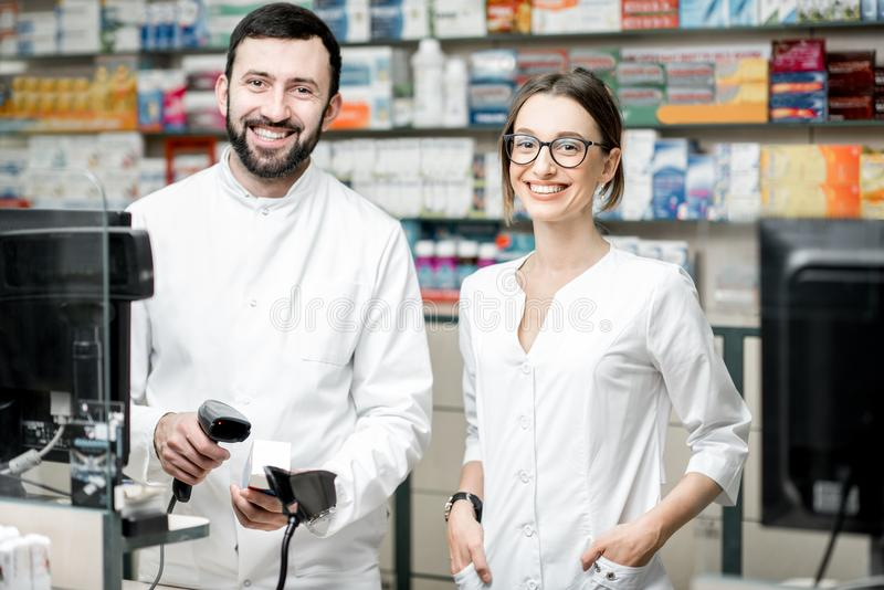 Pharmacists working in the pharmacy store stock photography