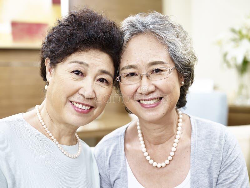 Portrait of two senior asian women stock photography