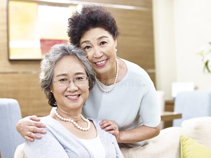 Portrait of two senior asian women stock photos