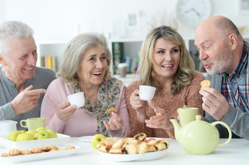 Portrait of two senior couples having breakfast stock photo