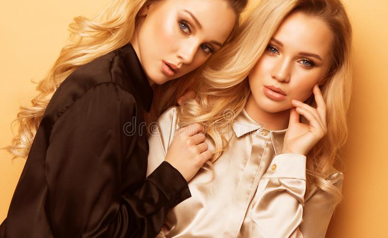 Portrait two pretty beautiful women, fashion style clothes. stock images