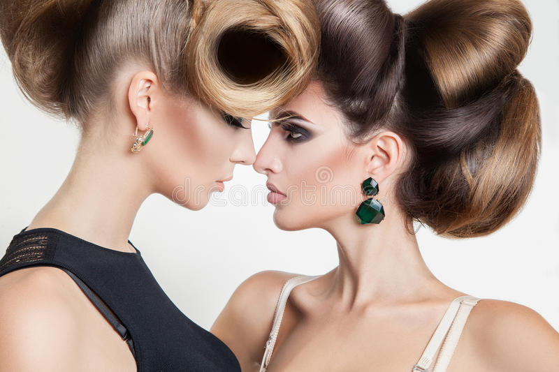 Portrait of two women in studio with volume creative hairst stock image