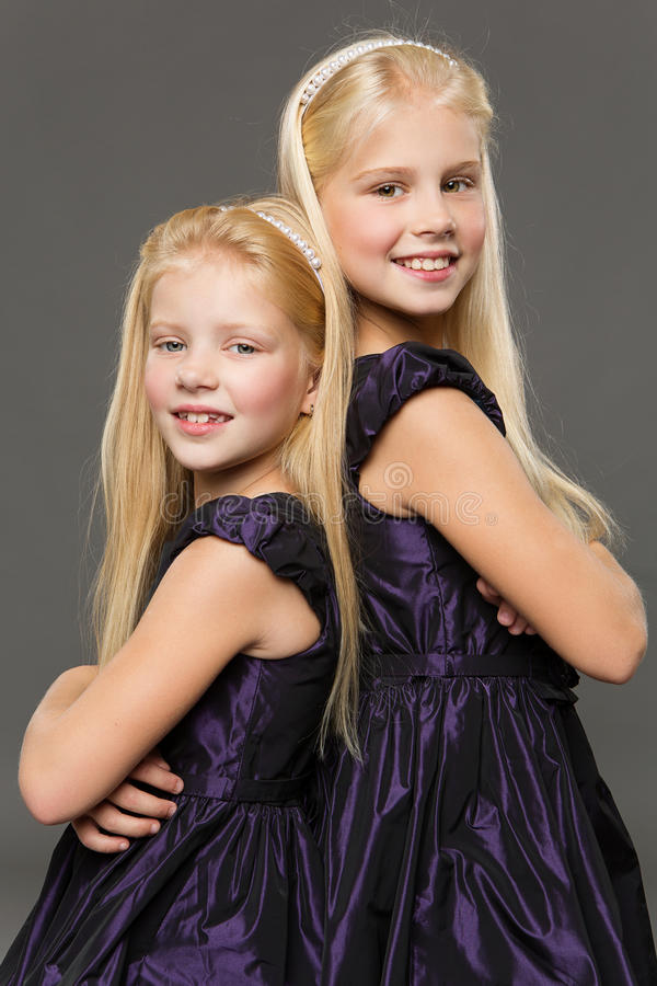Portrait of two sisters stock image