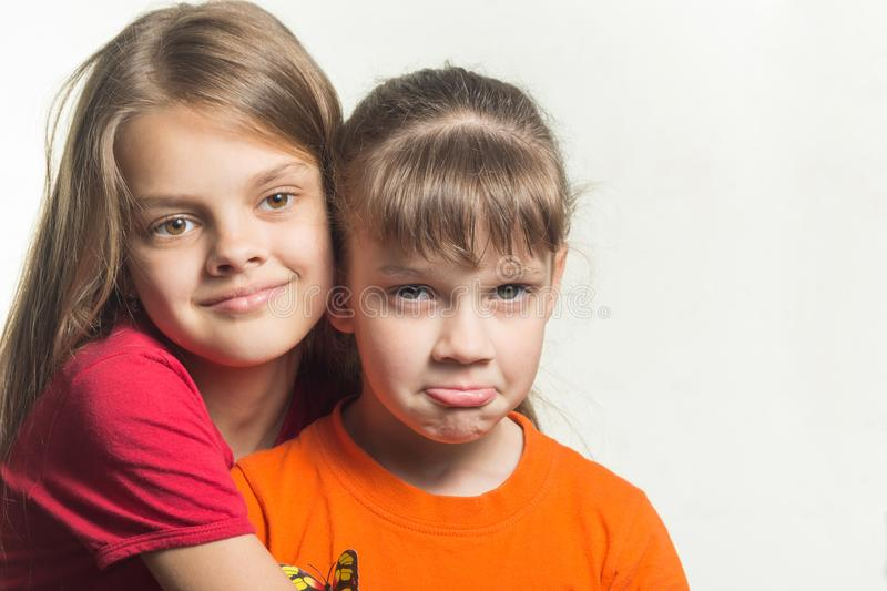 Portrait two sisters with different characters. Portrait of two sisters with different characters royalty free stock photo