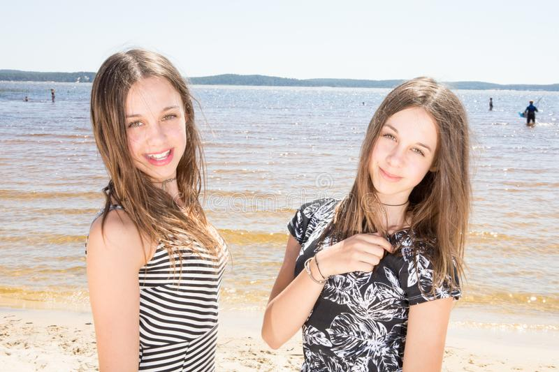 Two sisters twins in the summer beach vacation beauty teenager girls stock images