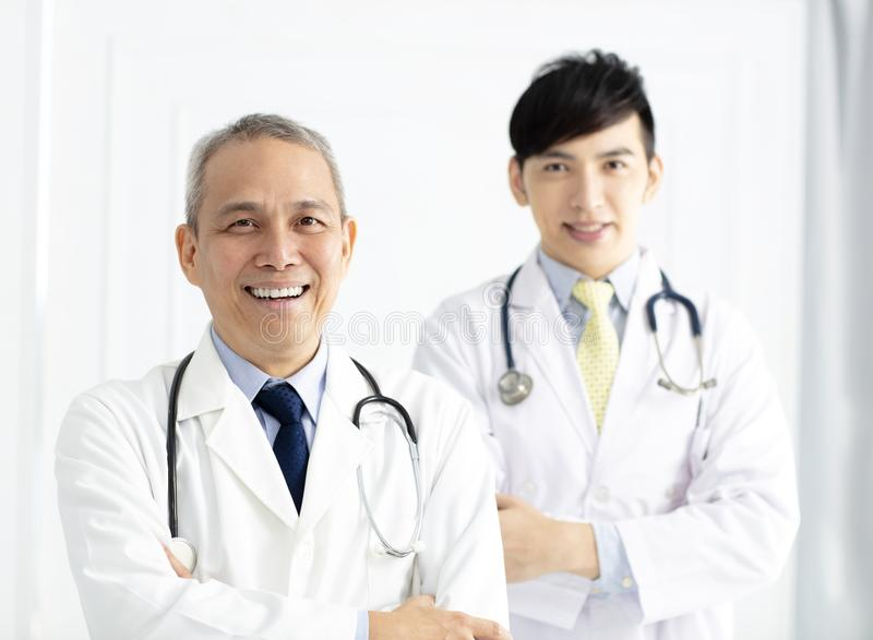 Portrait of two smiling asian doctors stock photos