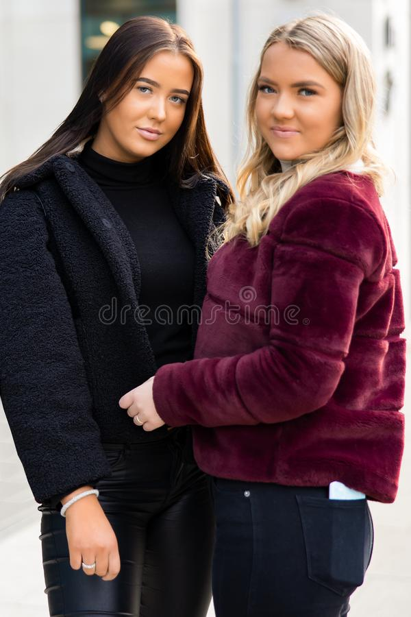 Portrait Of Two Smiling Beautiful Young Women Friends In City stock image