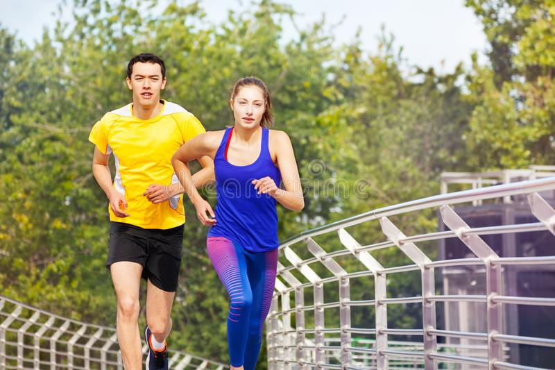 Sporty people running during outdoor workout stock image