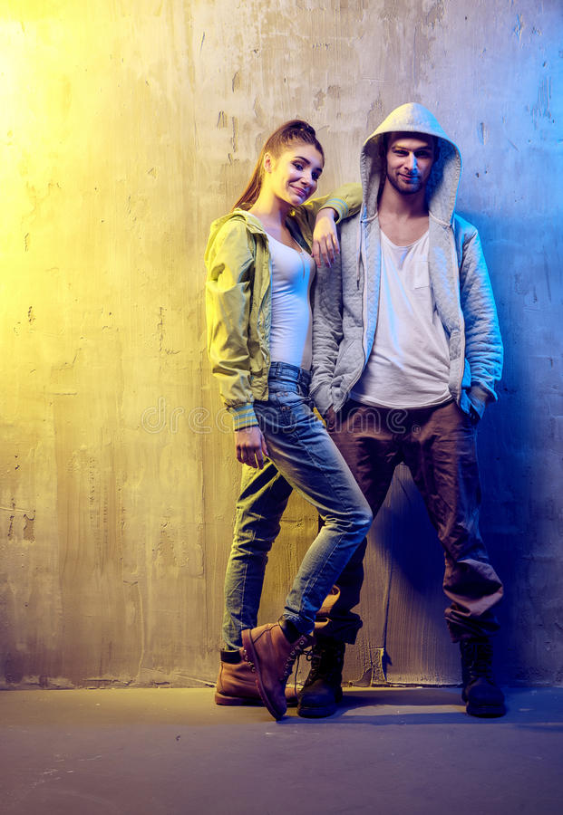 Portrait of two talented hip-hop dancers on a concrete background. Portrait of two young hip-hop dancers on a concrete background stock image