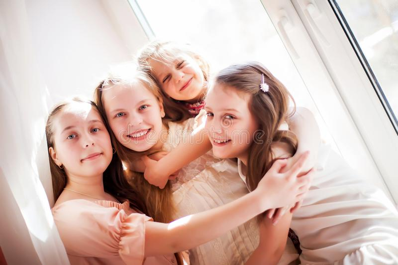 Two sisters with two cousins at home stock photos