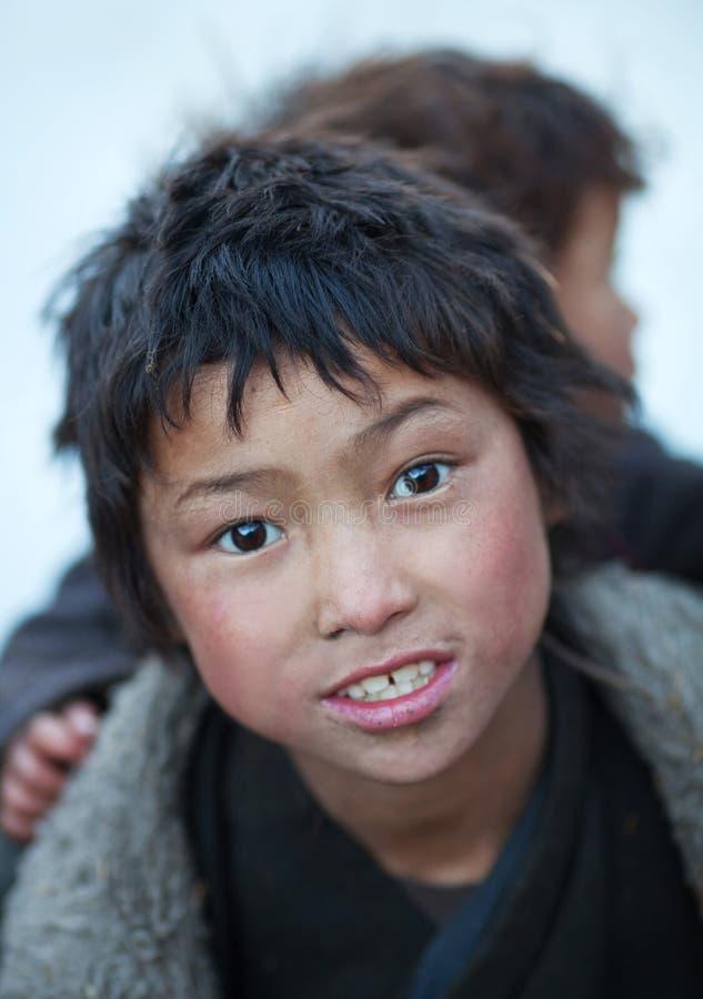 Portrait of two tibetan boys royalty free stock photography