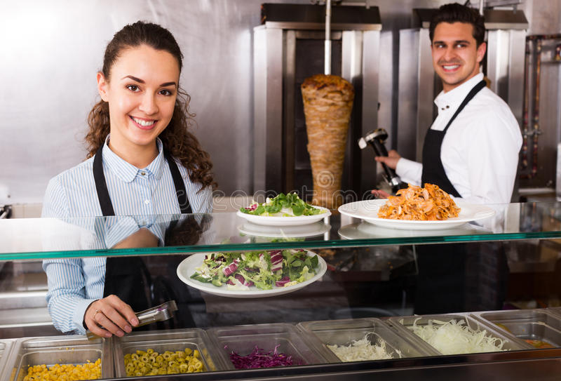 Portrait of two workers with kebab royalty free stock image