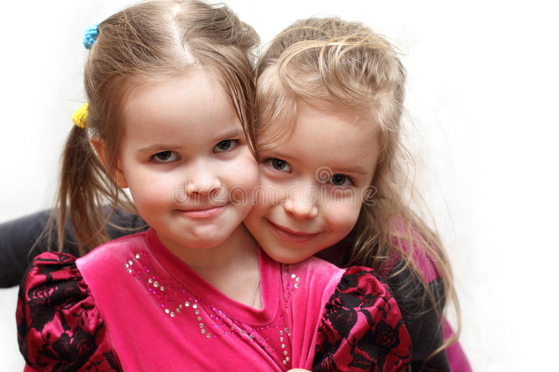 Portrait of two young adorable sisters stock photos