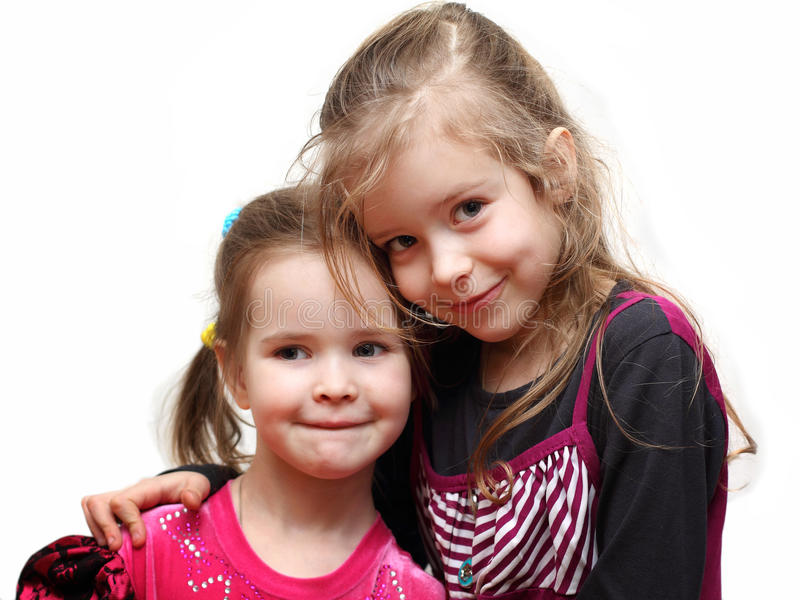 Portrait of two young adorable sisters royalty free stock images
